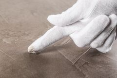 Free Person In White Glove Checking Cleanliness Of Beige Table, Closeup Royalty Free Stock Images - 171774999