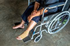 Person injured sit on wheelchair. Royalty Free Stock Images