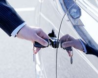 Person Inserting Car Key Stock Images