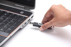 Person inserting a usb drive into a laptop Stock Photo