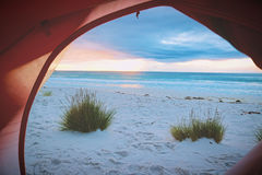 Person Inside Tent Watching Shore Line View during Sunset Stock Photography