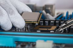 Person Installing Central Processor In Motherboard Stock Photos