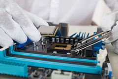 Person Installing Central Processor In Motherboard Royalty Free Stock Photos