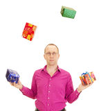 Person juggling with some colorful gifts. A business person juggling with some colorful gifts Stock Photography