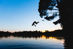 Person Jumping on Lake Silhouette Photograph Royalty Free Stock Image