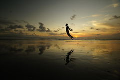 Person Jumping Into Lake With Sunset in the Far Horizon Stock Photography