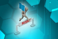 Person jumping over word risk with flag Royalty Free Stock Photo