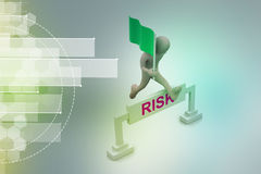 Person jumping over word risk with flag Stock Images