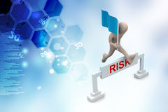 Person jumping over word risk with flag Royalty Free Stock Image