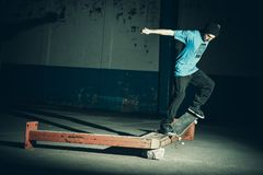 Person jumping with skateboard, trick in the street and urban style stock images
