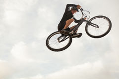 Person jumping on trial bike Royalty Free Stock Photo
