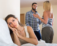 Person keeping silence turned away from friends Royalty Free Stock Photos