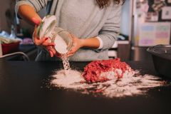 A person kneading minced meat royalty free stock photo