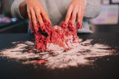 A person kneading minced meat stock image