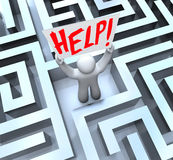 Person in Labyrinth Maze Holding Help Sign Royalty Free Stock Photo