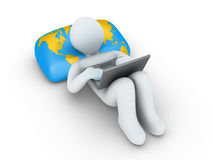 Person with laptop is browsing the internet. 3d person using a laptop is lying on a pillow with the world map Royalty Free Stock Photos