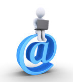Person with laptop sitting on e-mail. 3d person using a laptop is sitting on an e-mail symbol Stock Image