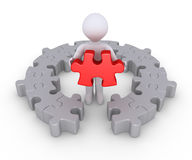 Person and last puzzle piece. Person is holding the last puzzle piece of a circular puzzle Royalty Free Stock Photography