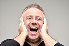 Person Laughing non rasato Fotografia Stock