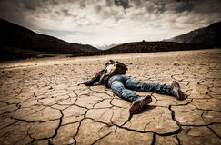 Person lays on the dried ground Royalty Free Stock Photos