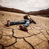 Person lays on the dried ground Stock Image