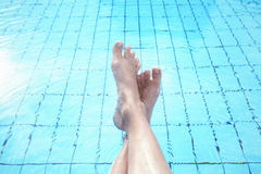 Person legs in the pool water Stock Photography