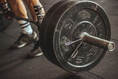 Person Lifting Barbell Stock Images