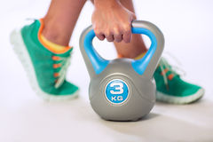 Person lifting kettlebell Royalty Free Stock Photo