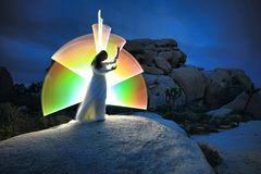 Person Light Painted in the Desert Under the Night Sky royalty free stock images