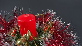Person lighting the candle on holiday ornament Royalty Free Stock Photo