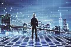 Person looking at big data. Person in hoodie looking at new york city with digital big data interface. Technology and innovation concept. Double exposure royalty free stock image