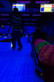 Person looking at a bowling alley with balls behind him Stock Photography