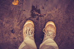 Person looking at his or her shoes in the mud Royalty Free Stock Photography