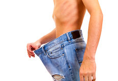 Person lose a Weight. Skinny Young Man lose the Weight on the White Background Stock Photos