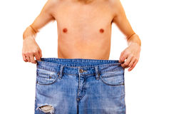 Person lose a Weight. Skinny Young Man lose the Weight on the White Background Royalty Free Stock Photography