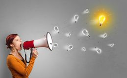 Person with loudspeaker. Person talking in megaphone with bulb, new idea concept stock images