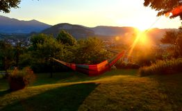 Enjoying a scenic view over a lush valley relaxing in a hammock royalty free stock images