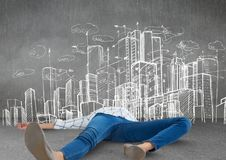 Person lying with creative burnout exhaustion by city drawings Stock Photography