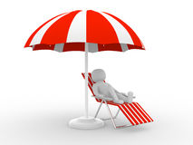A person lying on a lounge chair enjoying his holiday under an u Stock Photos
