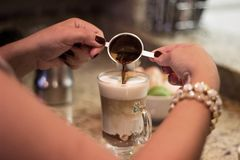 Person Making a Cappuccino Coffee stock images