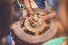 Person Making Clay Pot in Front of Girl during Daytime Stock Photography