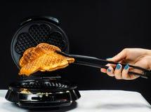 Person making fresh waffles Royalty Free Stock Photos