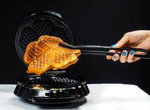 Person making fresh waffles royalty free stock photography