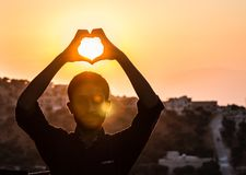 Person Making Heart Shape With His Hand During Sunset Royalty Free Stock Image