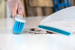Person making household Cleaning with Brush and Shovel Royalty Free Stock Image