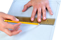 Person making a template on textile Royalty Free Stock Photography