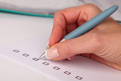 Person marking in a checkbox Royalty Free Stock Photos