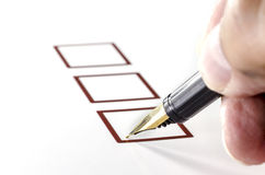 Person Marking in a Checkbox on white paper. Stock Photos