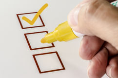 Person Marking in a Checkbox on white paper. Royalty Free Stock Photo