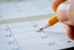 Person marking the date of the 15th Royalty Free Stock Photography